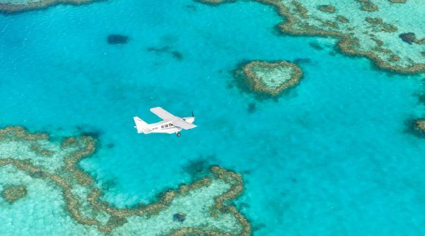 Fly directly over the famous Heart Reef